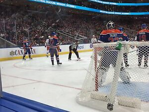 Red Wings/Oilers Row 1 on the glass
