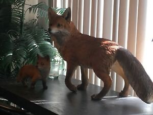 Realistic garden red fox statue with pup