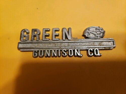 Green--Subaru--Gunnison,Co.- Metal  Dealer Emblem Car  vintage SM403