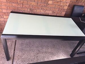 Wooden dinning table with glass top Maryland Newcastle Area Preview