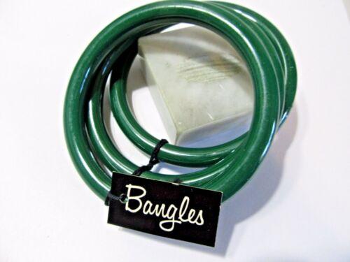 SHINY DARK GREEN COLOR SET OF THREE PLASTIC BANGLES DARK WITH ORIGINAL TAGS