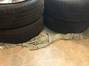 Set of Ram 1500 OEM 20 inch rims and tires.  Almost new.