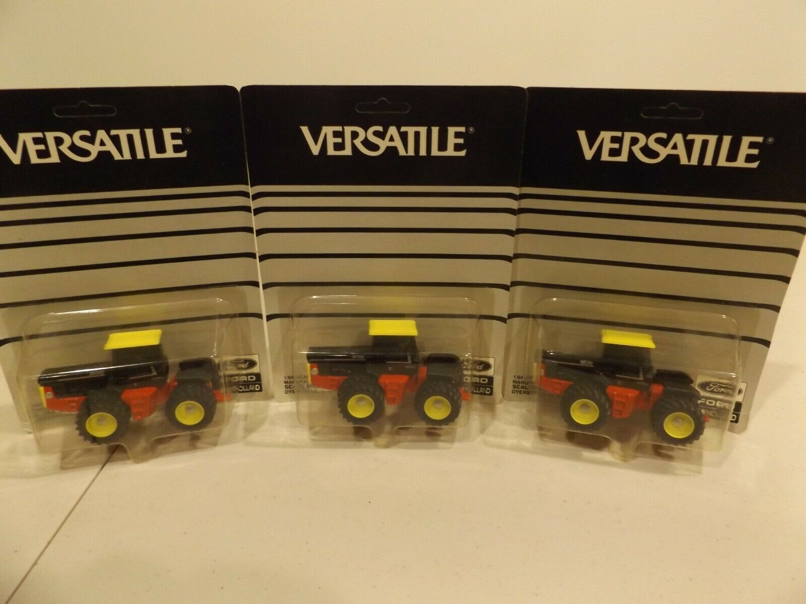 VERSATILE 836, 876, 936  4WD'S with YELLOW RIMS  AND CAB ROOFS  by  SCALE MODELS