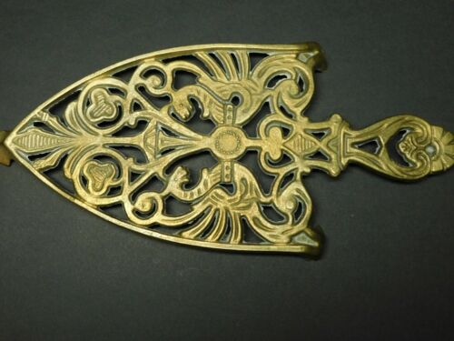 Footed Brass Colored Cast Iron Sad or Flat Iron Trivet