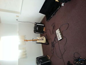 Fender stratocaster and amps and pedals.