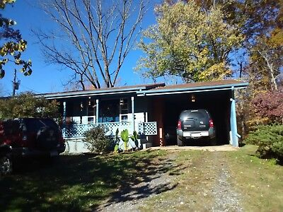 2 br. 1 bath home on 4.60 acres of creek front property in western n.c.