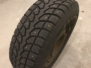 "Four 16"" Studded Winter Claw Tires on Rims"