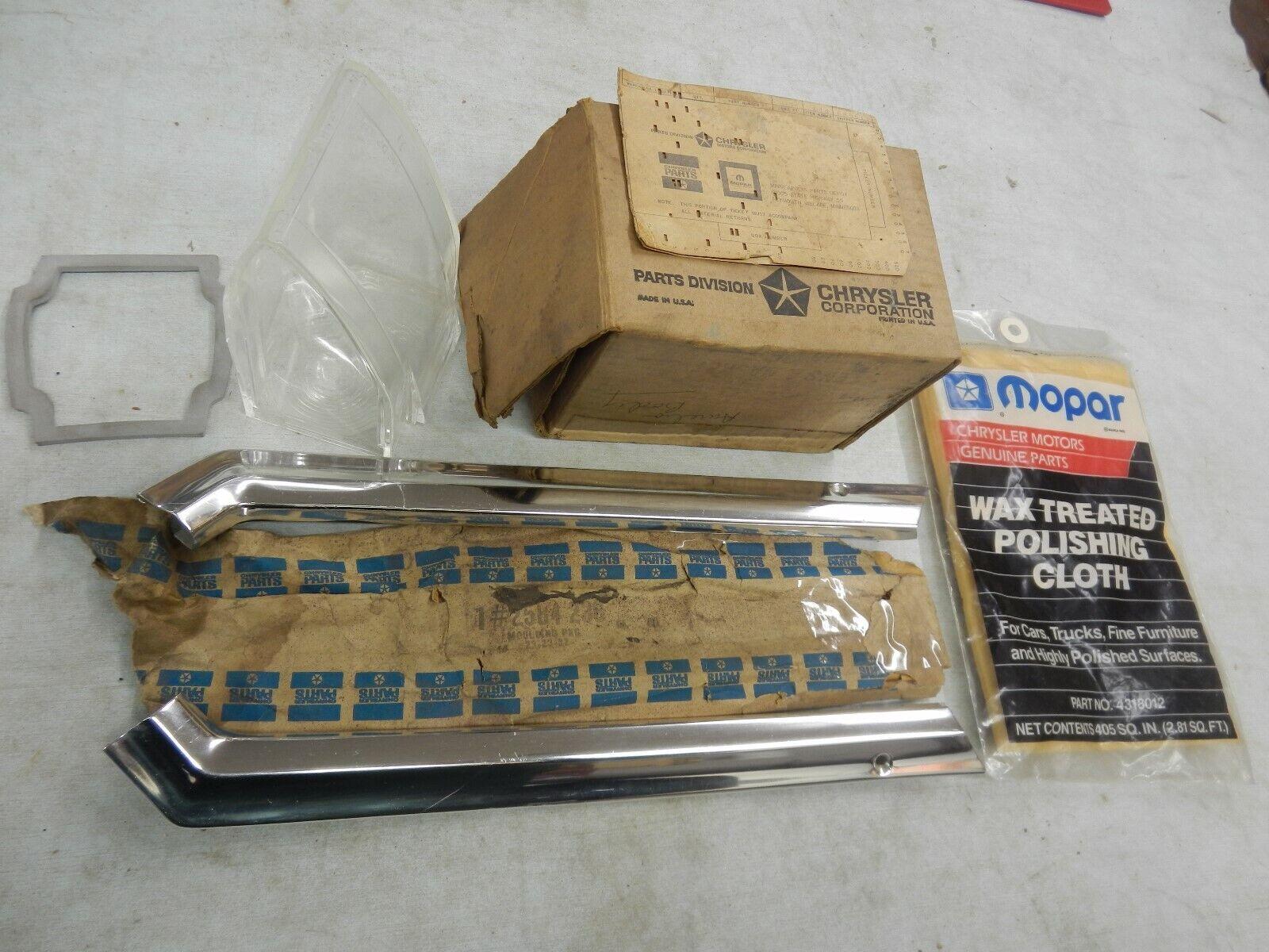 Park lamp lens, mouldings, Polishing Cloth, Radio knobs 1963/75 Mopar NOS