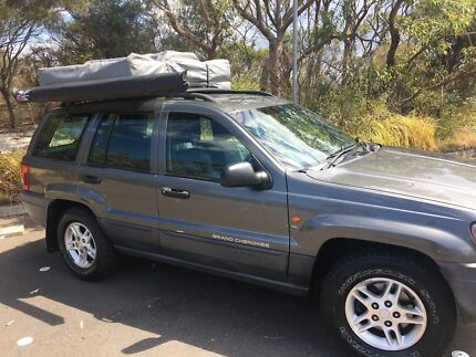 Jeep Grand Cherokee with Roof Top Tent (6 Day Offer)