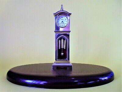 A stunning quartz Grandfather clock made in solid brass