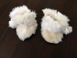 Very cute cream coloured fuzzy baby slippers (6-12 months)
