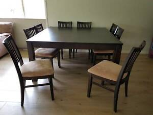 Square hardwood dining table with 8 Chairs