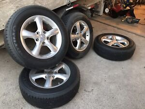 "Set of 4 15"" polished aluminum wheels with tires"