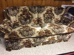 Six foot long couch/ Hide a Bed
