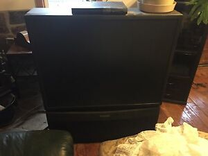 Panasonic big screen TV and tower, 2 tub chairs