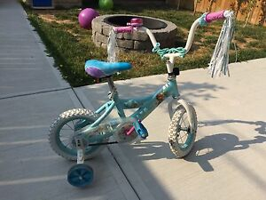 Children's frozen bicycle with training wheels.