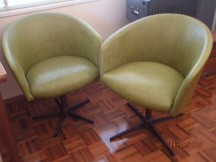 Retro style green pair of chairs
