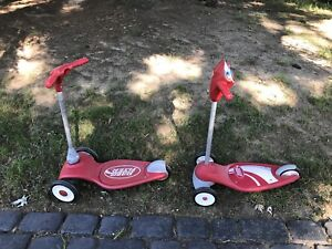 2 red radio flyer kids scooters
