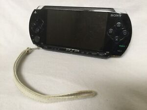 PSP —- with storage card and 4 games
