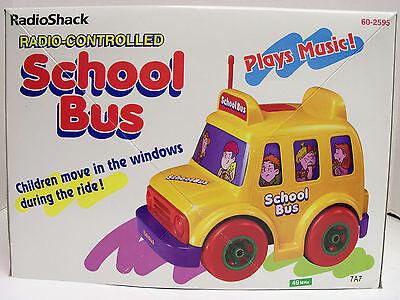 NEW RADIO SHACK   RADIO-CONTROLLED SCHOOL BUS CHILDREN MOVE IN THE WINDOWS
