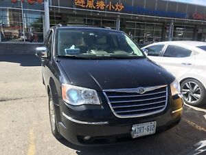 2010 Town & Country fully loaded black on beige leather