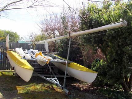 Windrush Surfcat 14 Catamaran with mainsail, jib, flip up rudders