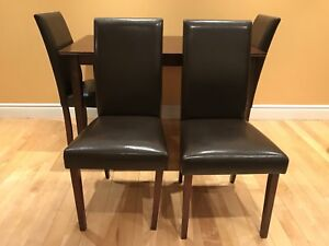 Dark brown wood dining table and parsons dining chairs