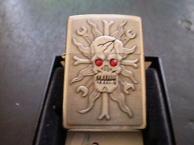 "ZIPPO / "" THE WRENCHING SCULL "" WITH A FANTASTIC RAISED DESIGN AND CRYSTALS"