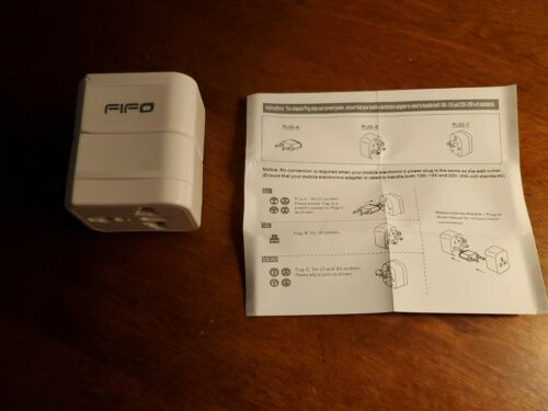 FIFO - World Travel Adapter Outlet - NEW Out Of Package  - $5.00