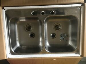 Double kitchen sink and Moen faucet