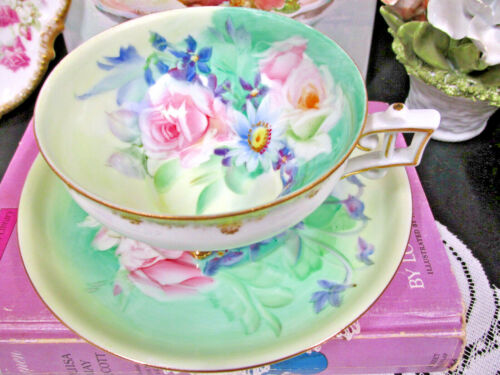 Japan Lefton tea cup and saucer painted pink roses sits on 4 feet teacup daisy
