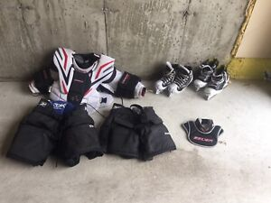 Goalie skates, chest protector, pants, neck guard