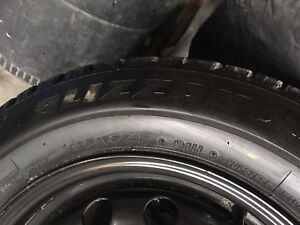 Bridgestone BLIZZAK 195/65R15 snows/black steel rims