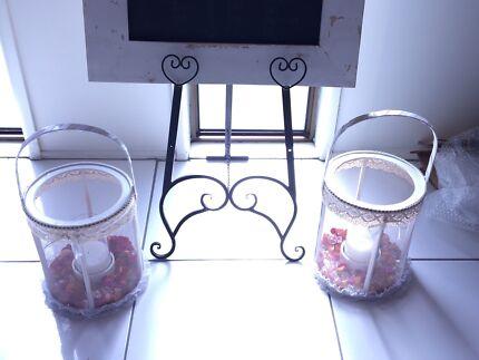 2 large basket candle holders $60
