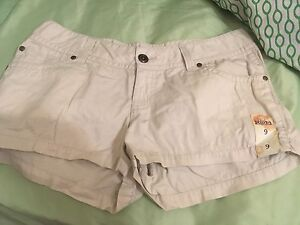 Short shorts brand new with tags. Size 7-9 medium. Beige.