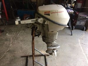 Two old Johnson outboards. 6? And 9? Hp
