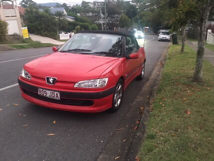 Red Peugeot Convertible 306