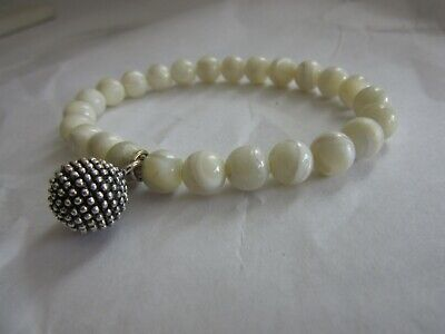 Polished mother of pearl beaded stretch bracelet w/silver tone bead charm Mother Of Pearl Beaded Bracelets