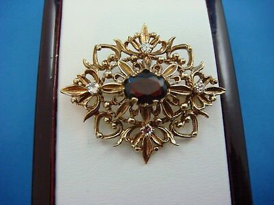 "ANTIQUE ""RAPSODY"" 14K YELLOW GOLD OVAL GARNET AND DIAMONDS BROOCH 6.3 GRAMS"