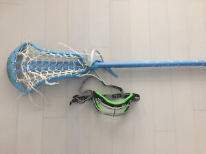 Lacrosse stick and goggles