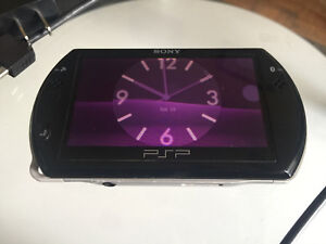 PSP GO( CUSTOM FIRMWARE WITH 6 GAMES)- -PLAYS DOWNLOADABLE GAMES
