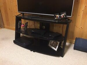 Tv stand with smoked glass shelves