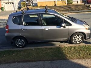 2008 Grey Honda Fit (includes winter tires on rims & roof racks)