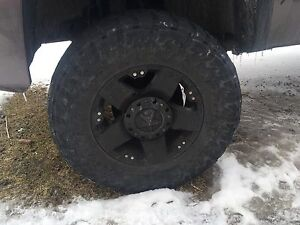 18 in rockstar rims and toto open country 35s