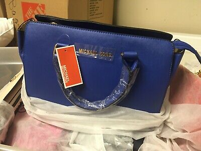 "A Famous design Blue purse. Large 15""l x11""tx6""w moved discounted"