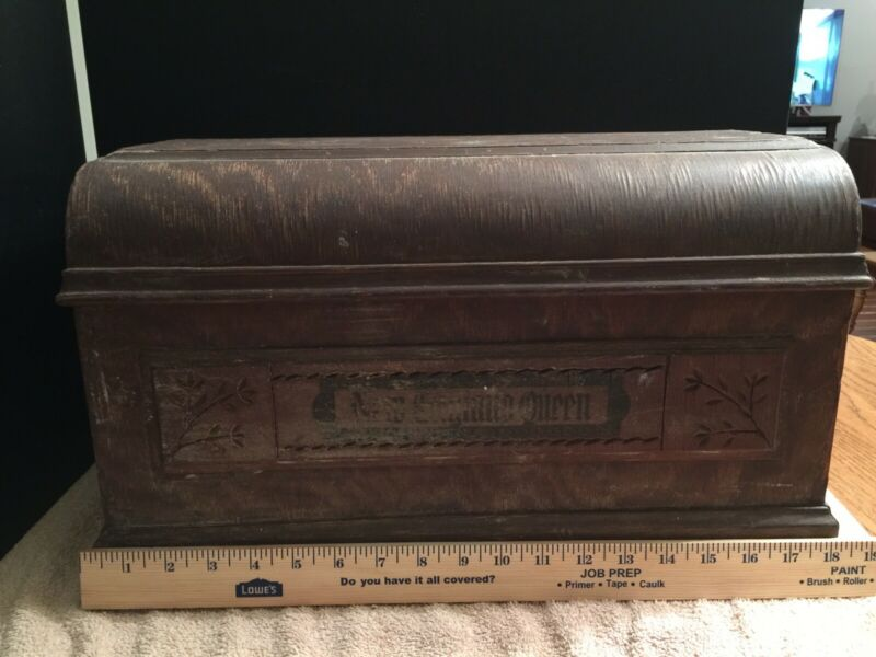 New England treadle sewing machine coffin top
