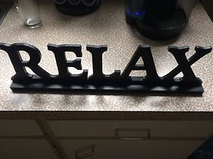 Black Wooden Relax Sign