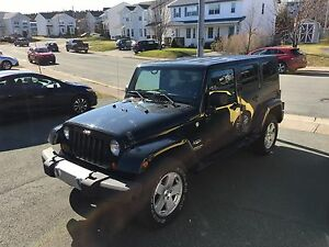 2012 Jeep Wrangler unlimited Sahara. Low mileage.