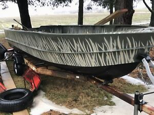 15 foot solid steel boat with trailer