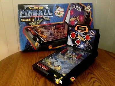 electronic lcd star fighter pinball game with 8 arcade game sounds in box 1991